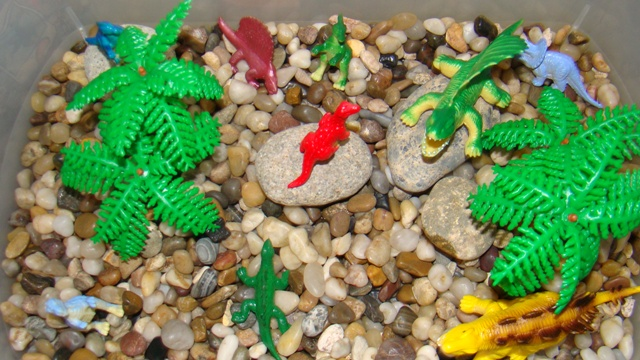 Sensory Tub made with Rocks and Crocs!